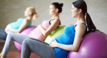 Pregnant women work out using exercise balls