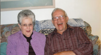 John Hughes shares a laugh with his wife, Doris.