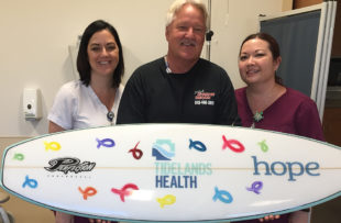 Tidelands Health cancer patient Harry Muiter is joined by infusion nurses Tara Wiggins, at left in photo, and Tricia Balazs.