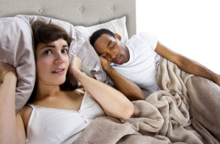 Woman unable to sleep due to snoring partner