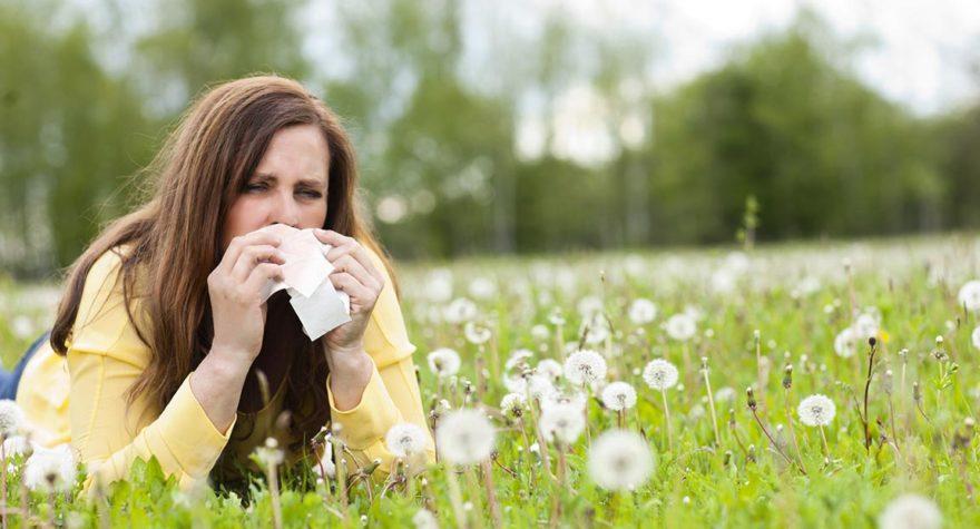 Woman suffering from seasonal allergies.
