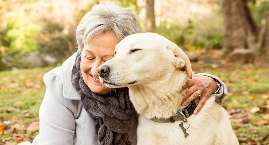 A woman hugs her dog