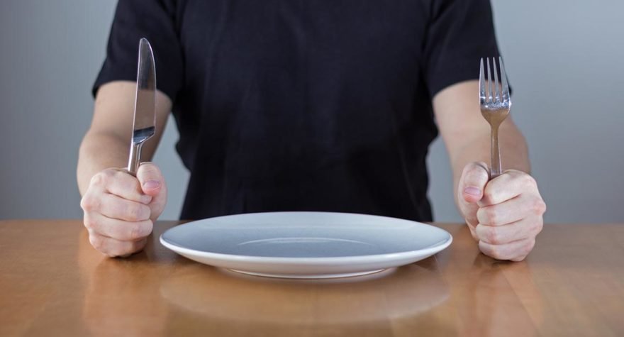 Man with empty plate