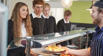 College students being served a meal.