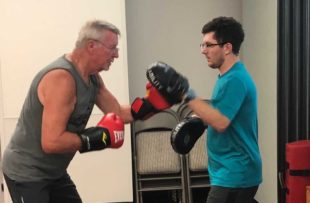 """George Brockhausen works out during the """"Power Through Parkinson's"""" class at Tidelands HealthPoint"""
