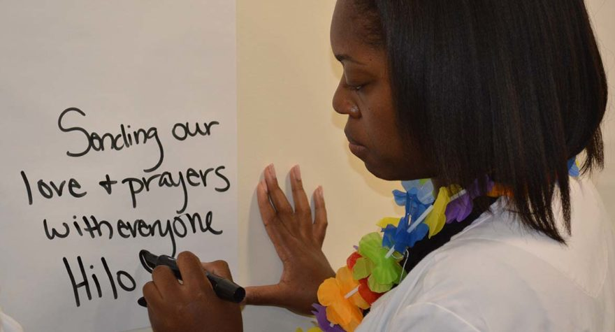 Regina Thompson offers a message of support to caregivers in Hilo.