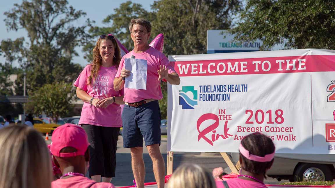 """Tidelands Health breast surgeon Dr. Craig Brackett speaks to the crowd at the 2018 """"In The Pink"""" Breast Cancer Awareness Walk"""
