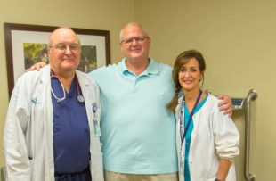 Hal James, center, smiles with Dr. Laurence Ballou, left, and Dana Waninger, a licensed practical nurse, at Tidelands Health Gastroenterology at Georgetown, where Hal was treated for colon cancer.