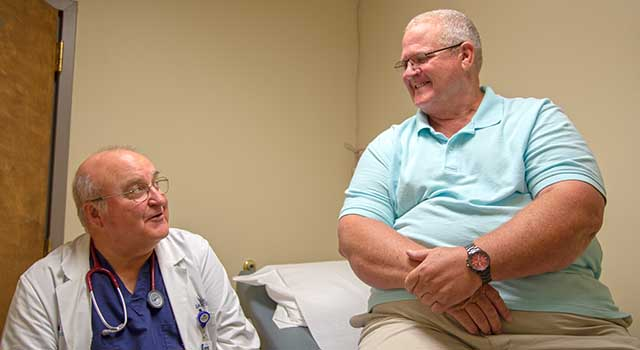 Hal James and Dr. Laurence Ballou chat inside a room at Tidelands Health Gastroenterology at Georgetown.