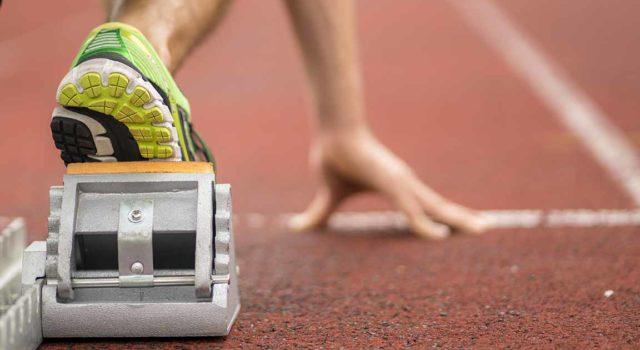 Runner at the starting line of track run.