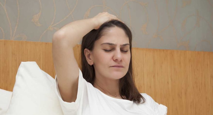 Young woman struggling with morning sickness