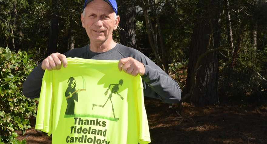 Jack Volker holds up a special shirt he had created to thank the team at Tidelands Health for the care he received.