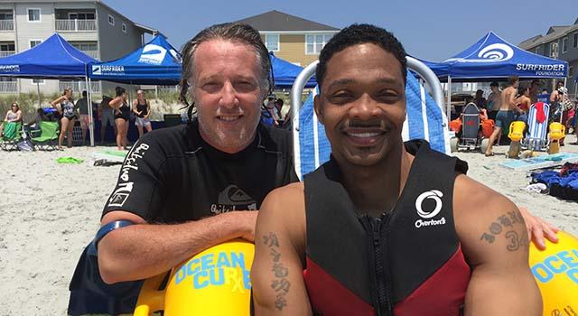 Ernie Johnson with his surfing partner, Tyler Watkins.