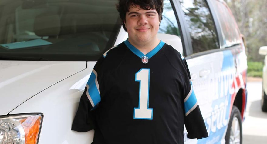 Travis Cunningham, who was born without arms, learned to drive with help from Ian McClure, a certified driver rehabilitation specialist with Tidelands Health.
