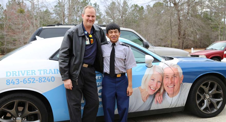 Jacob Bartlett, who has cerebral palsy, is among many people who has learned to drive in the 2015 Dodge Challenger used by the Tidelands Health driver rehabilitation program.