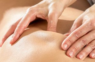 Hands massaging shoulder blade