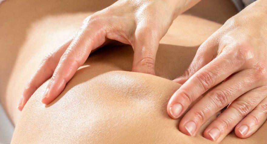Hands massaging shoulder blade