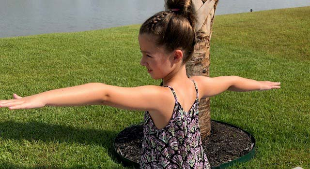 Addi is a big fan of yoga, one of the many ways she maintains and builds strength.