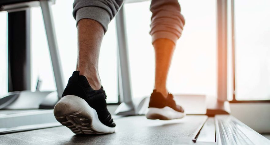 Close up on shoe,Man running in a gym on a treadmill.exercising concept.fitness and healthy lifestyle