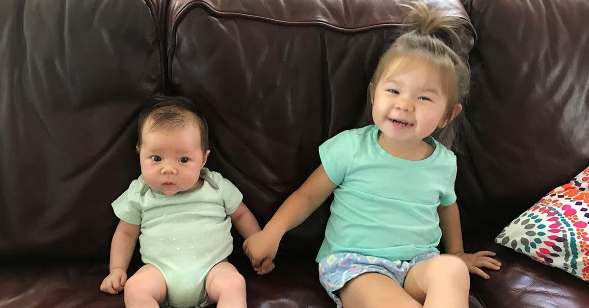 Dr. Monica Selander's oldest daughter Nora, 2, enjoys some time with her baby sister, Luna.