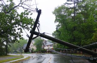 Electric pole knocked down by storm.