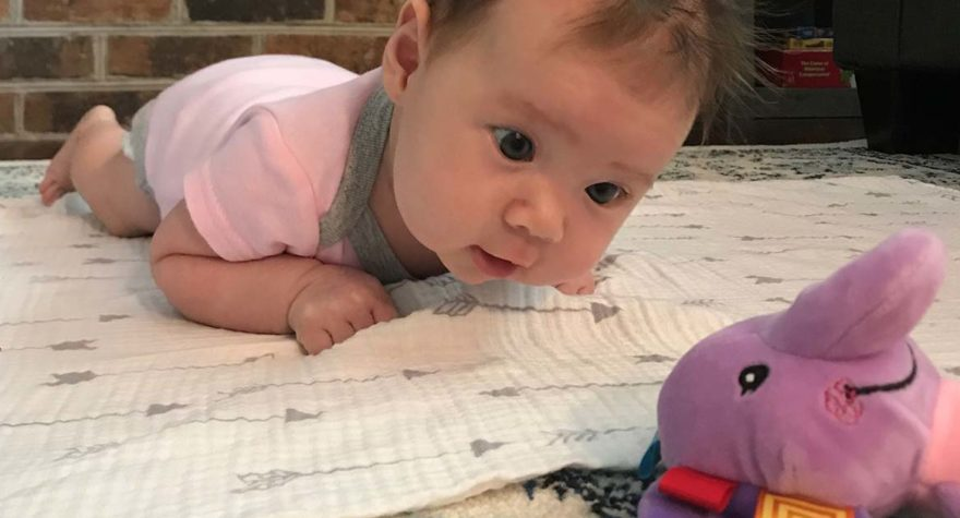 Like most infants, baby Luna isn't a fan of tummy time. But a little motivation - in the form of a stuffed animal - can help keep her entertained.