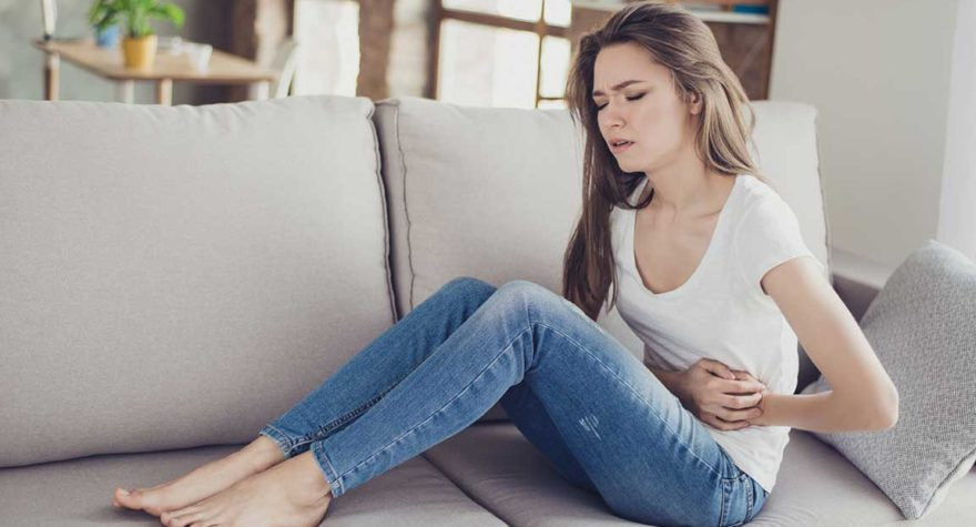 Woman struggles with abdominal pain.