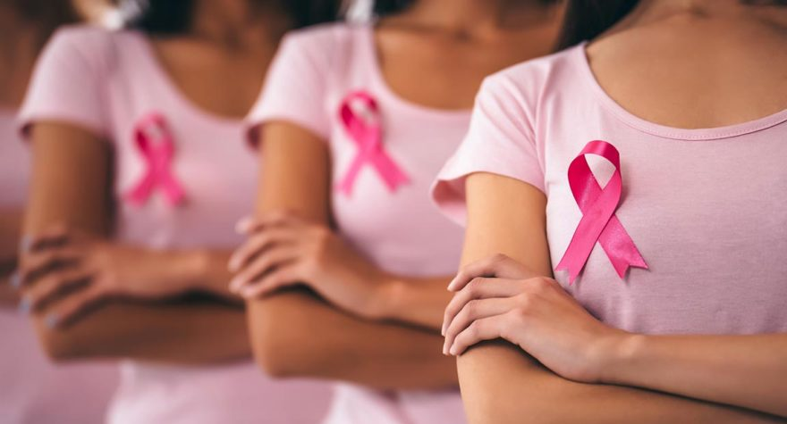 Women wearing pink ribbons.