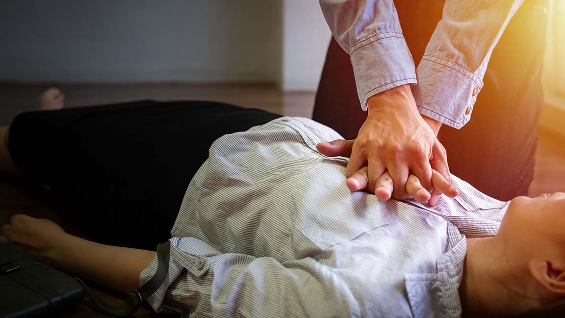 Individual performing CPR