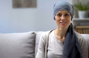Woman on couch after undergoing cancer treatments
