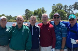 After recovering from COVID-19, Charles Costello, far right, is enjoying golf again.