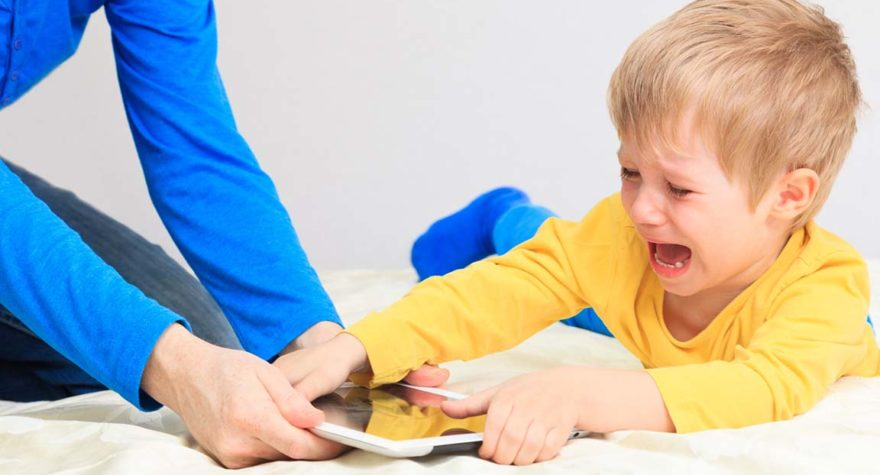 Child struggling to lose tablet