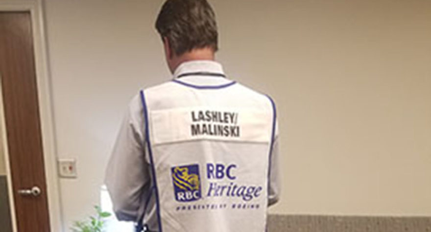Jeff Malinski, general manager of support services at Tidelands Health, sports the bib worn by the caddie of golfer Nate Lashley at the RBC Heritage golf tournament.