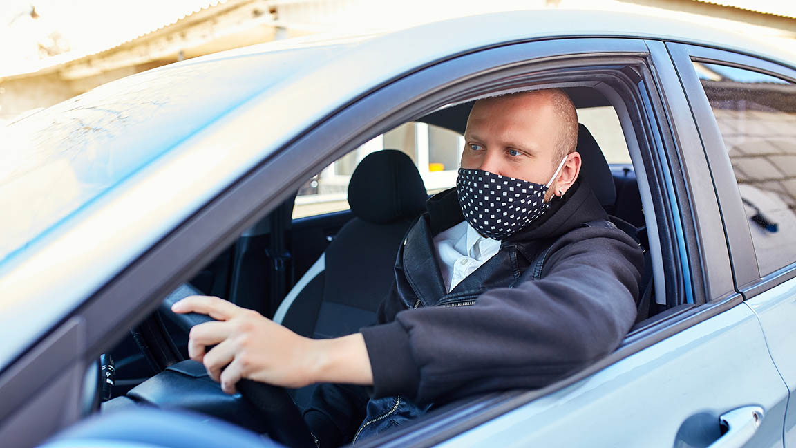 Man wearing a mask while driving