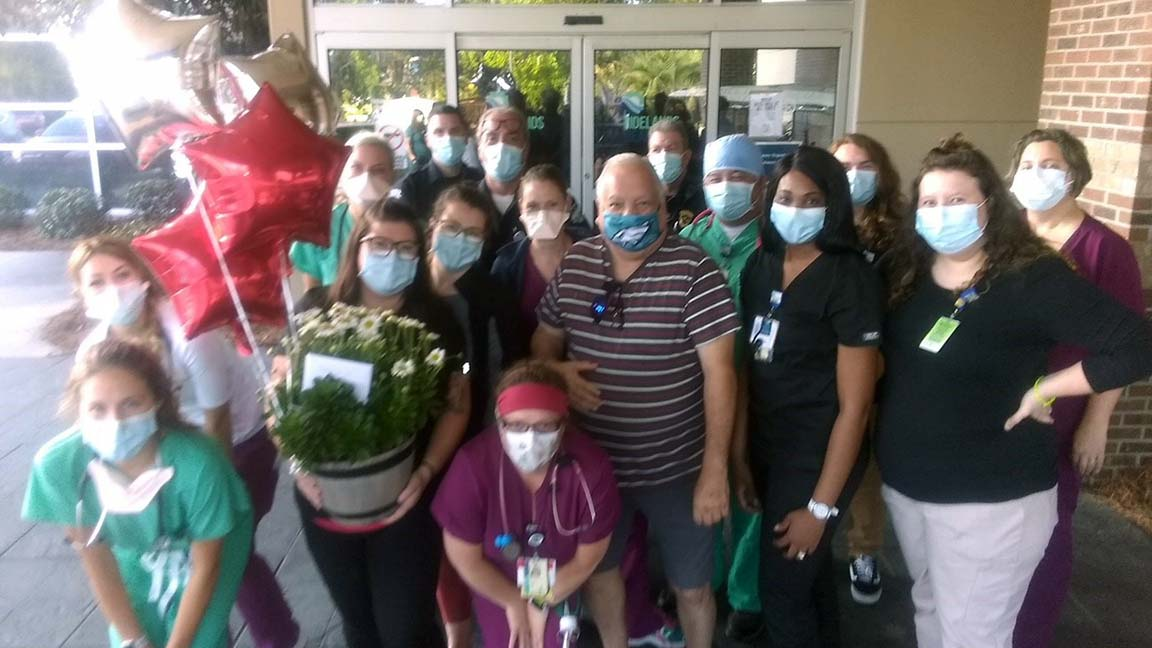 The team in the emergency department at Tidelands Waccamaw Community Hospital showed its heartfelt appreciation to Jim DeFeo for his tremendous support amid the COVID-19 pandemic by surprising outside the hospital with balloons, a mum plant and a gift card to a local restaurant.