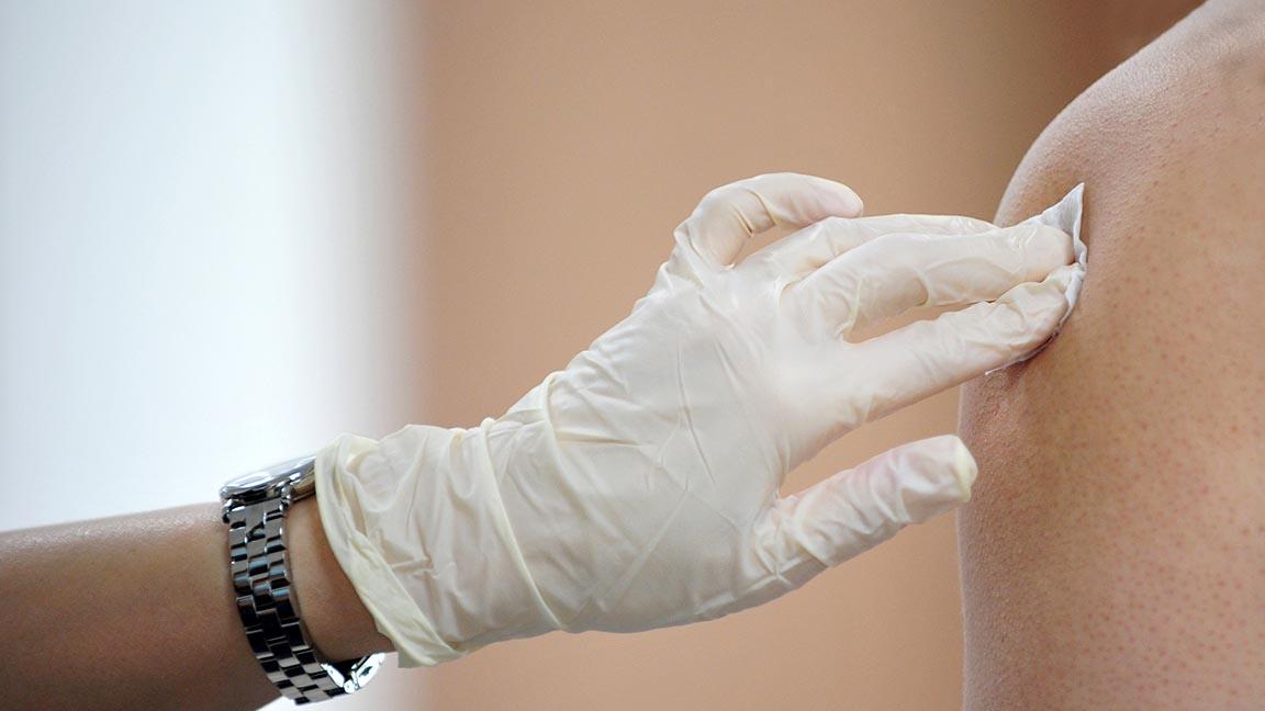 Patient receiving flu shot.