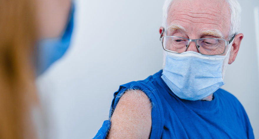 Man receiving a vaccine