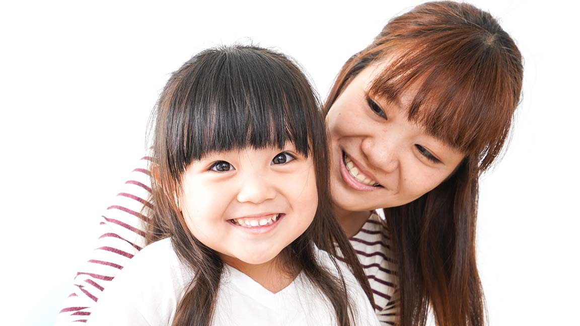 Mother and child smile
