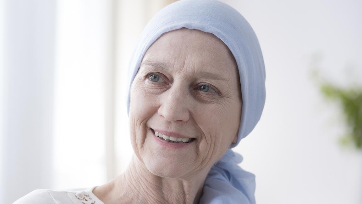 Happy woman wearing head scarf.