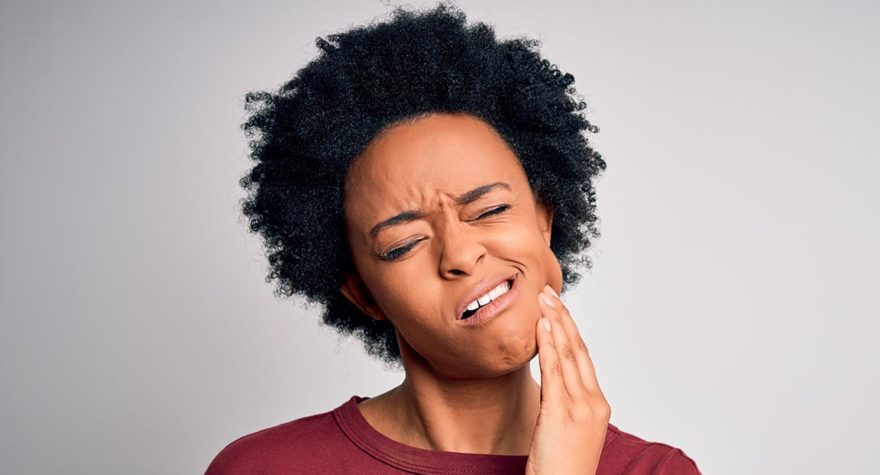 Young woman suffering from mouth pain.