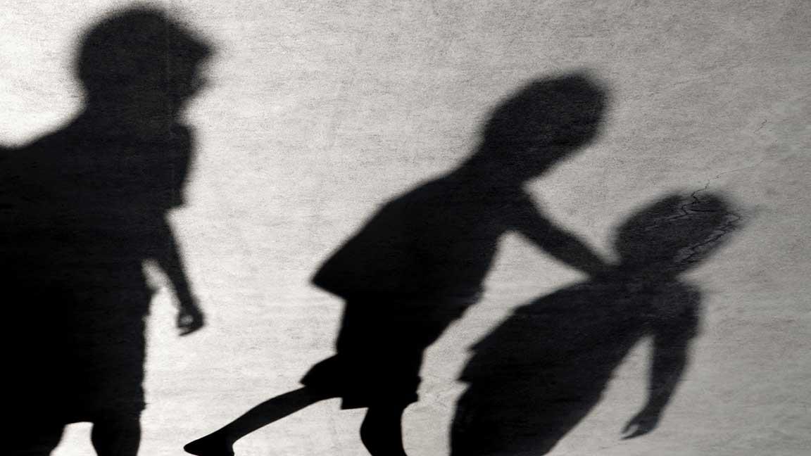 Three children walking together