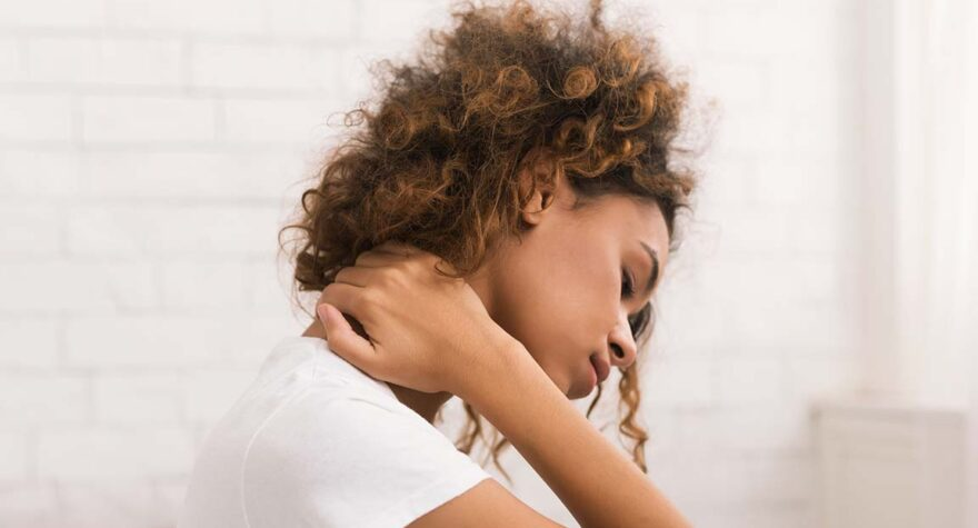 Woman struggling with neck crick.