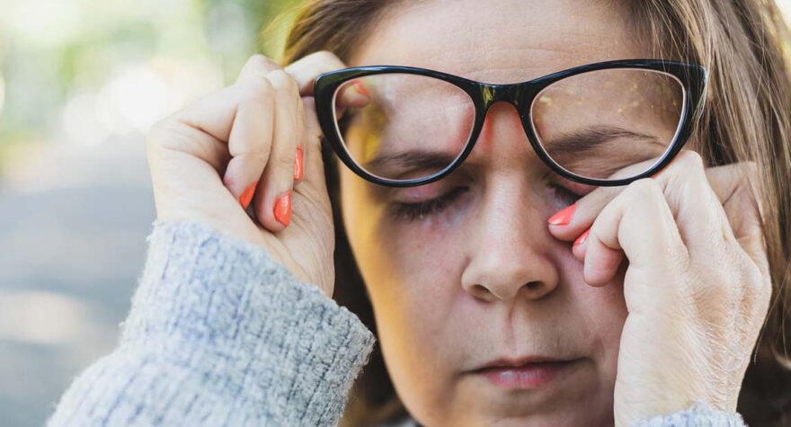 Woman rubbing itchy eyes
