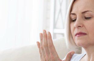 Woman massaging cold hands.