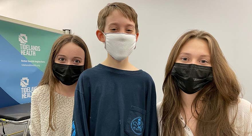 Like other members of their family, Isabel and Emma Keith were motivated to get the COVID-19 vaccine to help protect their brother, Jackson, at center, who has asthma.