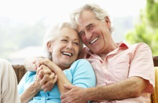 Senior couple laughing together.