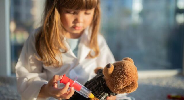 Little girl playing doctor.