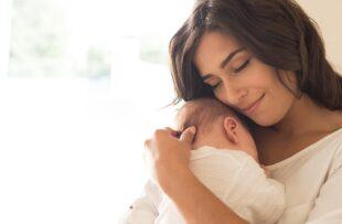 Woman holding newborn